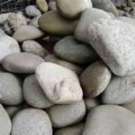 large landscaping rocks stacked in a pile