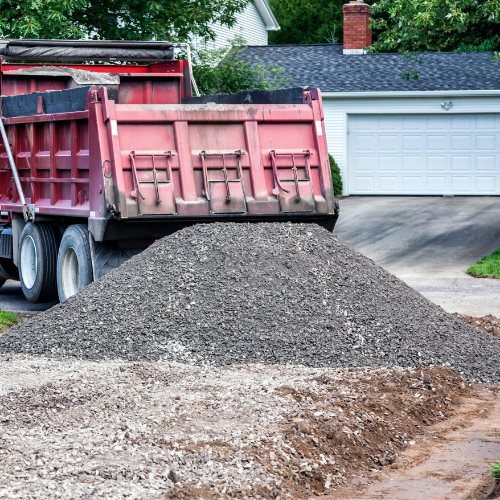 truck dumping materials for road building