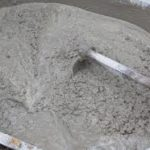 60/40 concrete being mixed in a wheelbarrow