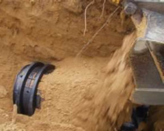 septic system being buried by dirt