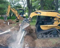 septic system being installed by construction machines