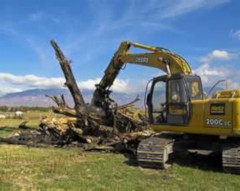 construction equipment doing site work in a field