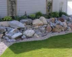 landscaping rocks on the side of a house