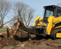 tree stump being removed by construction equipment
